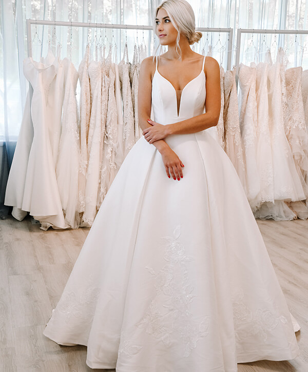 Bridal stylist modeling a wedding dress from private label Oxford Street, style PA1111