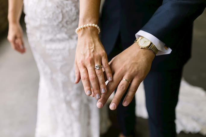 true bride Catie and husband showing their wedding rings