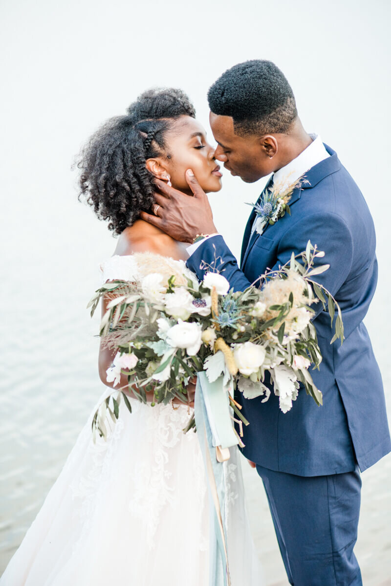 Trendy bride styled photo featuring groom and bride wearing essense of australia dress in style Style D2815