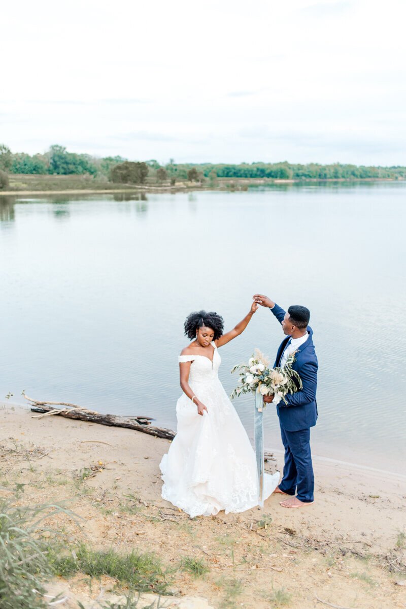 Trendy bride styled photo featuring groom and bride dancing