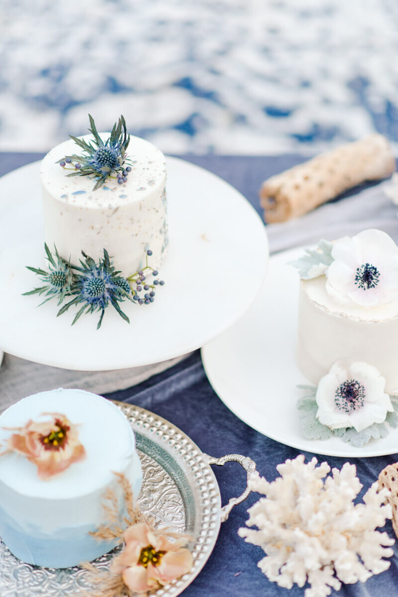 Trendy bride styled photo of wedding cakes on a table