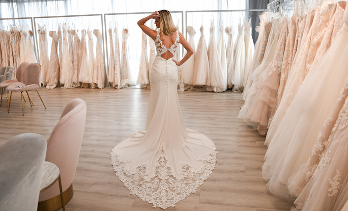 Model showing back of wedding dress Stella York Style 6834