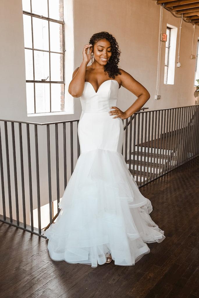 Model wearing wedding dress Essense of Australia D2027