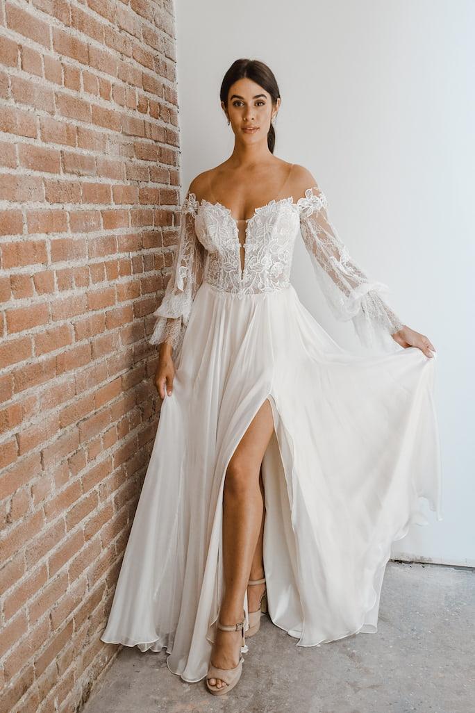 model wearing wedding dress All Who Wander Finn Gown