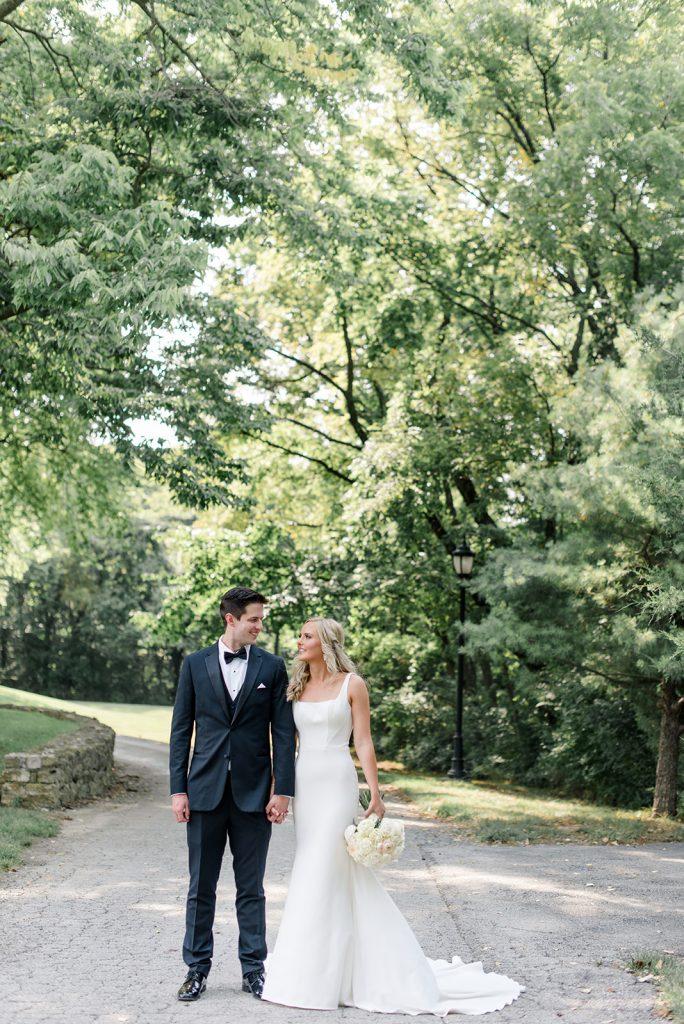 Real Martina Liana Bride and Groom posing for wedding photos