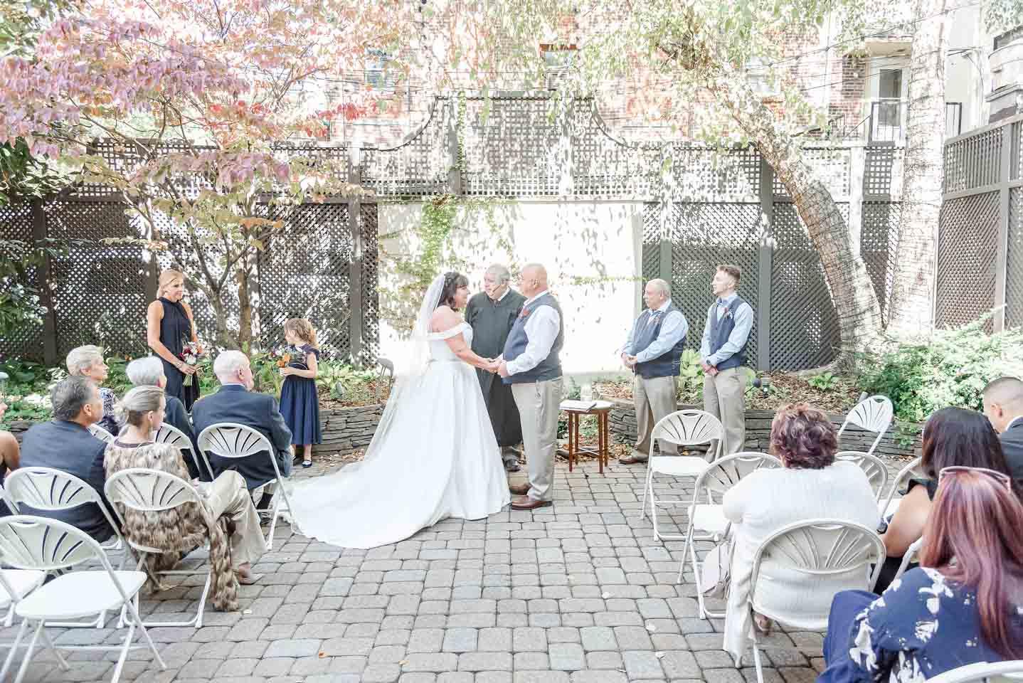 bride and groom hosting a virtual wedding ceremony