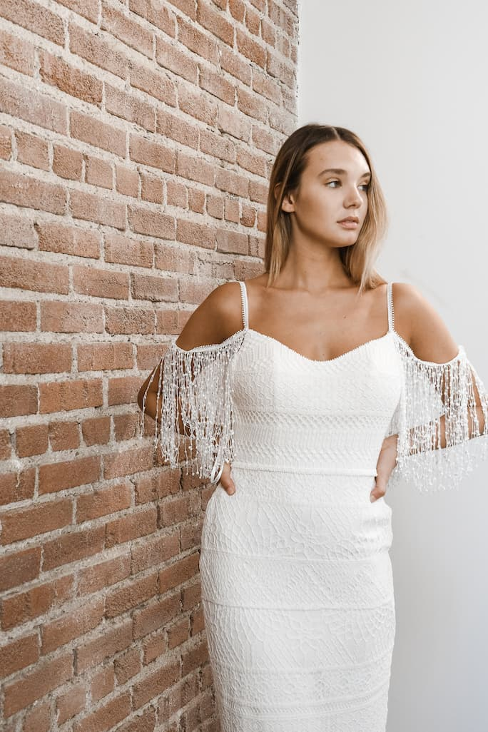 Boho all who wander wedding dress in style Asher with fringe off-the-shoulder sleeves