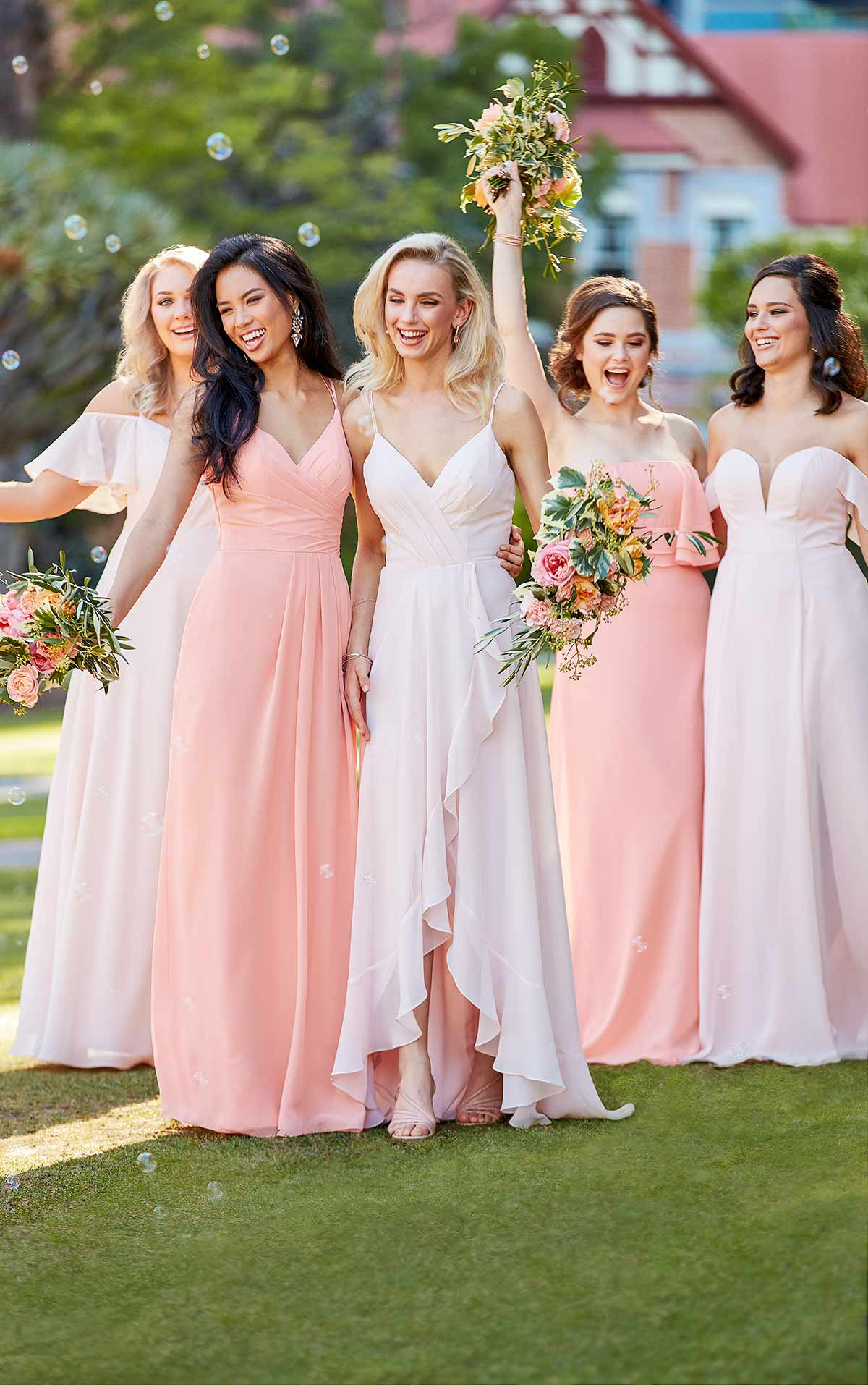mismatched bridesmaid dresses in pink colors and different styles