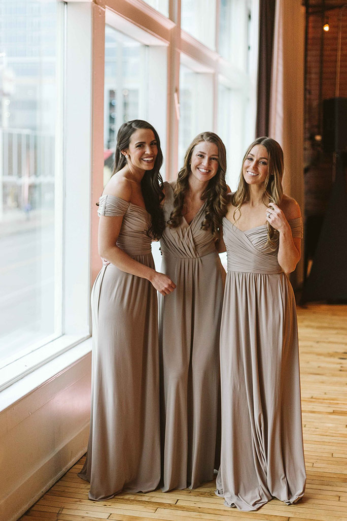 Mismatched style bridesmaid dresses in mauve color, gowns by Sorella Vita