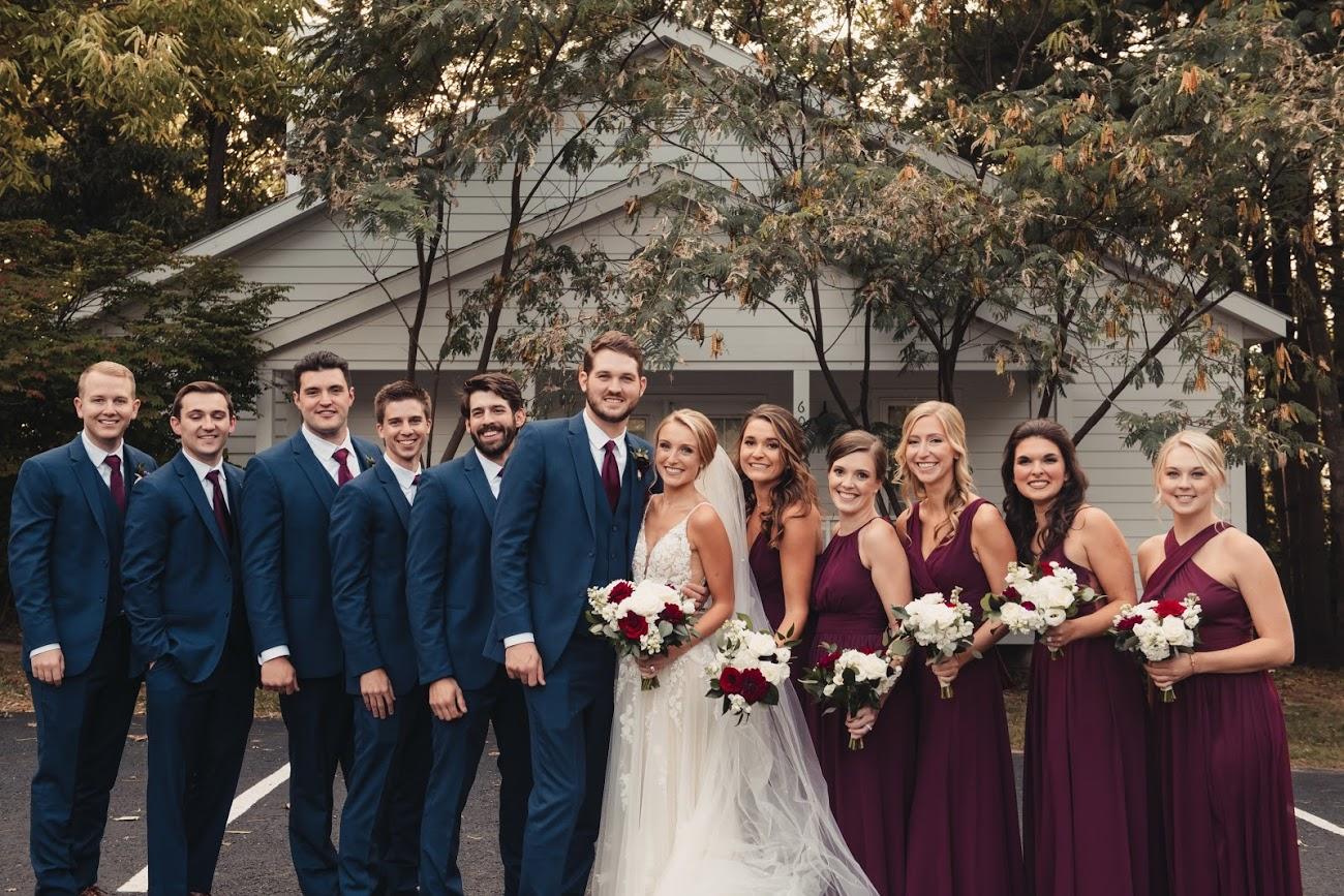 martina liana true bride posing for photo with bridesmaid and groosmen