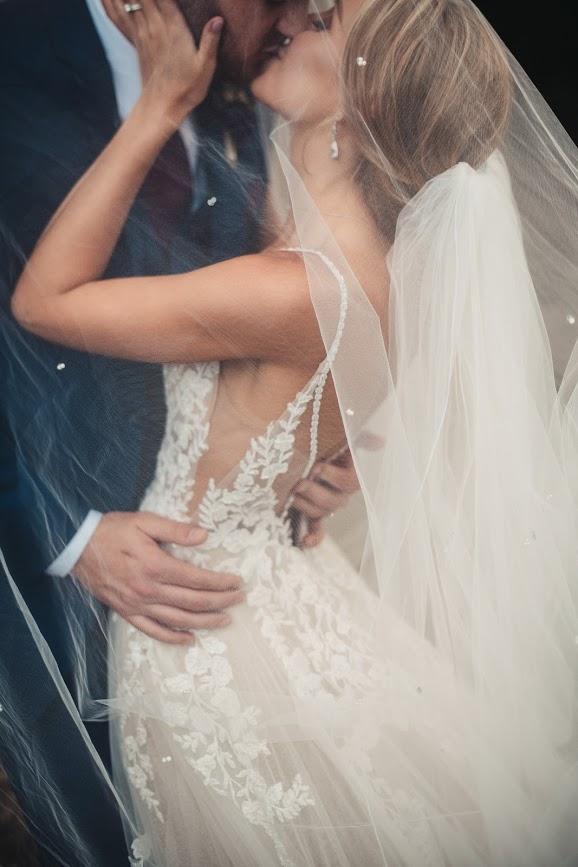 tru bride kissing groom for wedding photo
