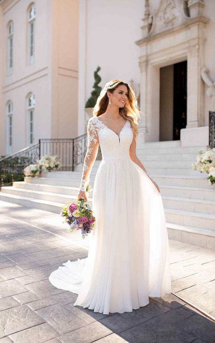 model wearing long sleeve lace wedding dress