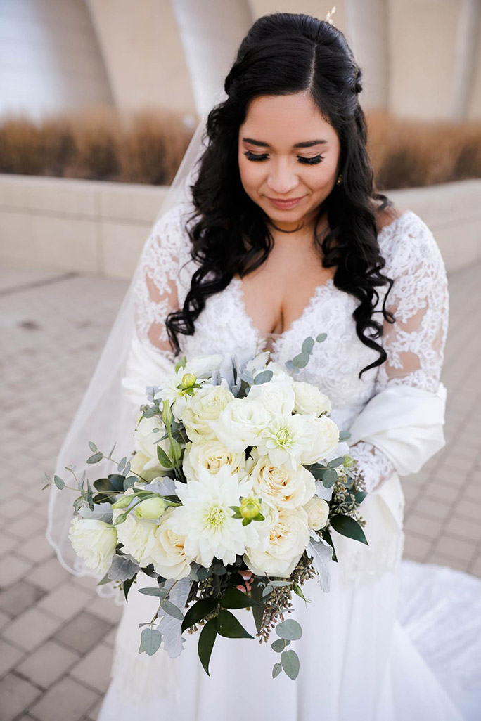 true bride julia wearing oxford street wedding gown and flower bouquet