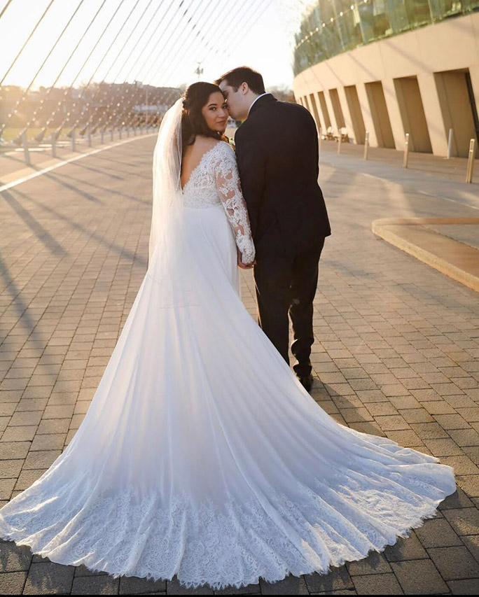 Train shot of True Bride Julia wearing wearing her lace wedding dress by Oxford Street, style PA1125