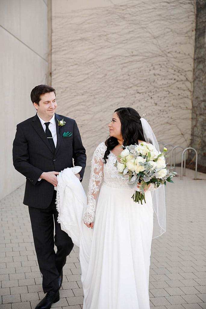 true bride Julia and husband Greg posing for photos