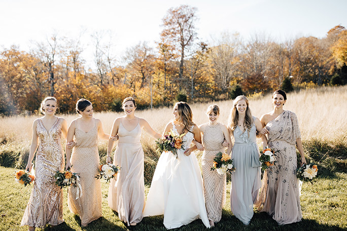 True Society Bride with her Bride Tribe wearing golden bridesmaid dresses
