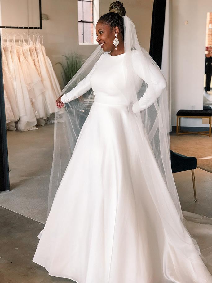 Bride wearing a long sleeved wedding dress by Martina Liana, style 1157 + 2050ST veil