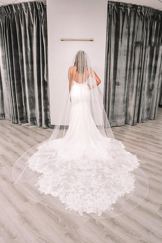 Bride wearing a Martina Liana wedding dress, style 1165 + 3651 veil