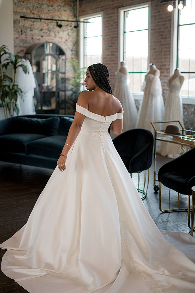 Bria Jones wearing off the shoulder wedding gown - style 1266 by Martina Liana