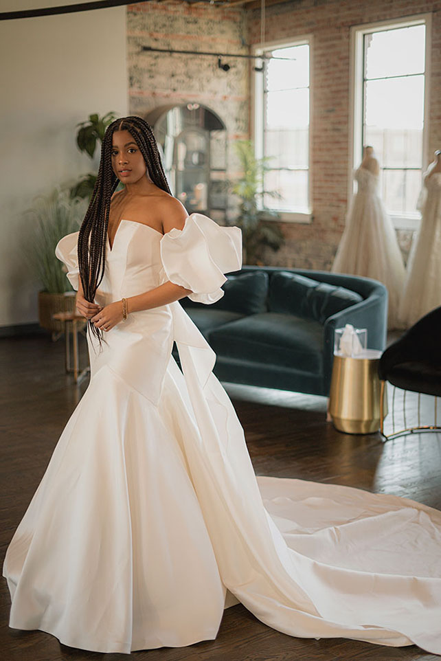 Bria Jones wearing mordern ballgown with puffed sleeves - style 1266 by martina liana