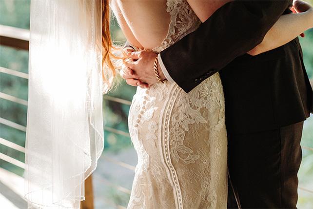 true bride harley and groom sharing a hug - style 905 by martina liana