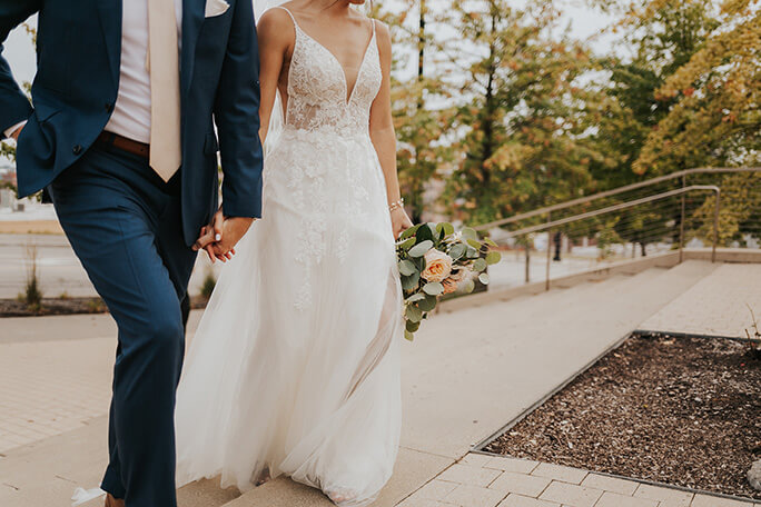real bride holding hands with husband - style D2840 by essense of australia