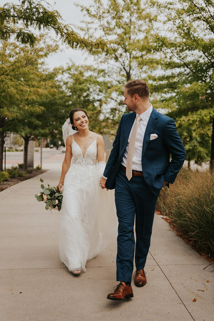 real bride katie and husband walking - style D2840 by essense of australia
