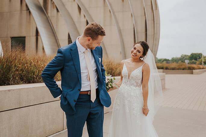 bride and groom at kauffman center in kansas city - style D2840 by essense of australia
