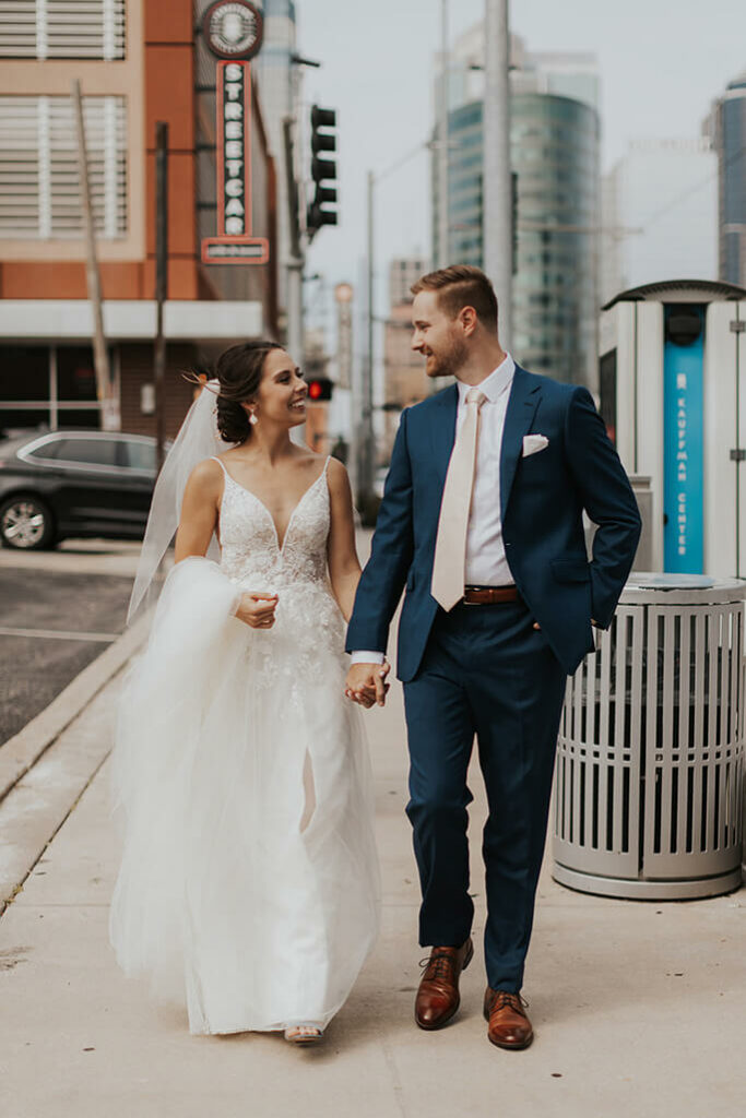 bride and groom walking in the city - style D2840 by essense of australia