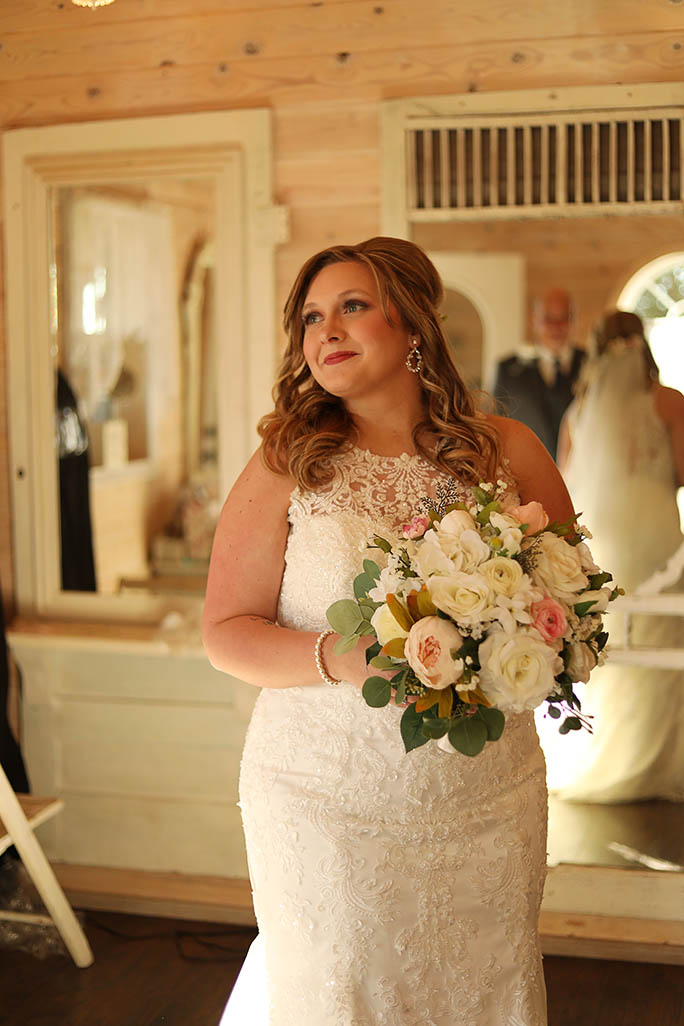real bride holding bouquet - style D2174 by essense of Australia