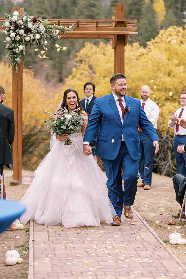 essense bride with groom at wedding venue