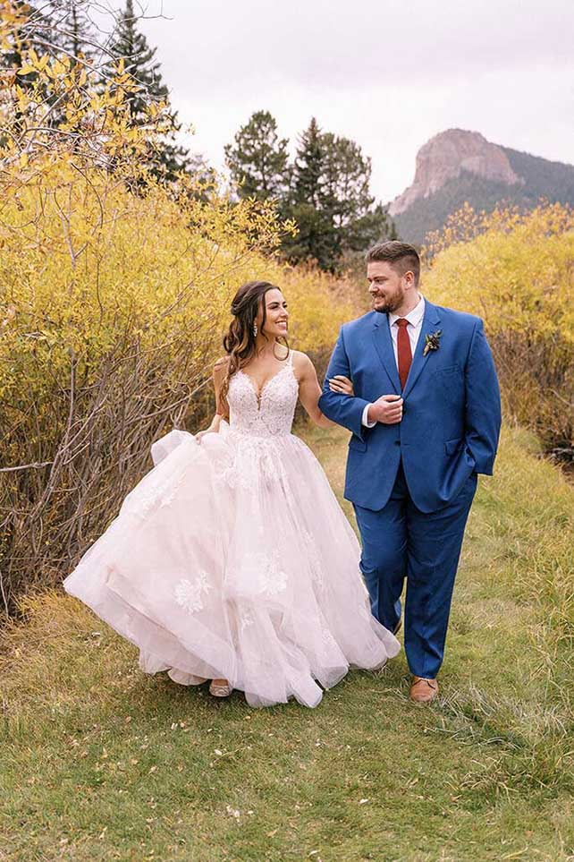 real bride Steffney and groom walking - style d2983 by essense of australia
