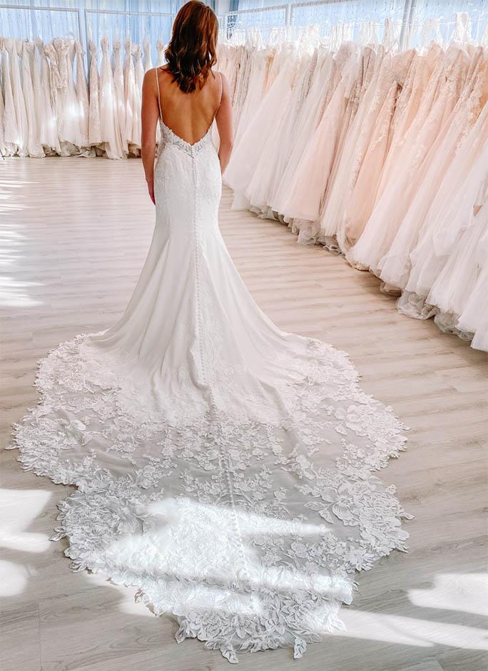 Model wearing mermaid wedding dress - style 1165 by martina liana