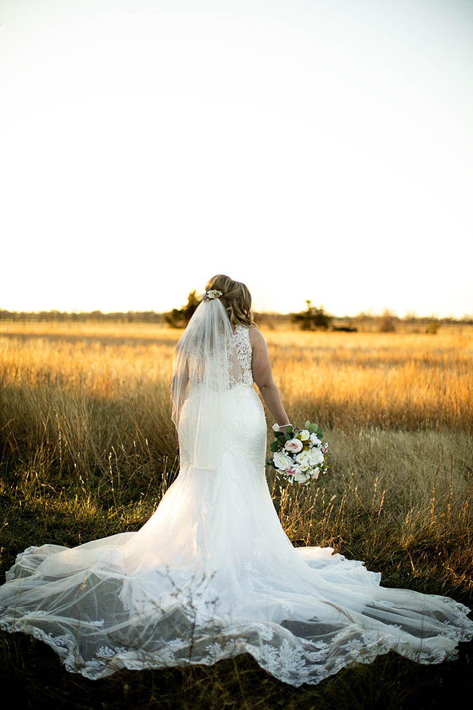 real bride holding flower bouquet - style D2174 by essense of Austral