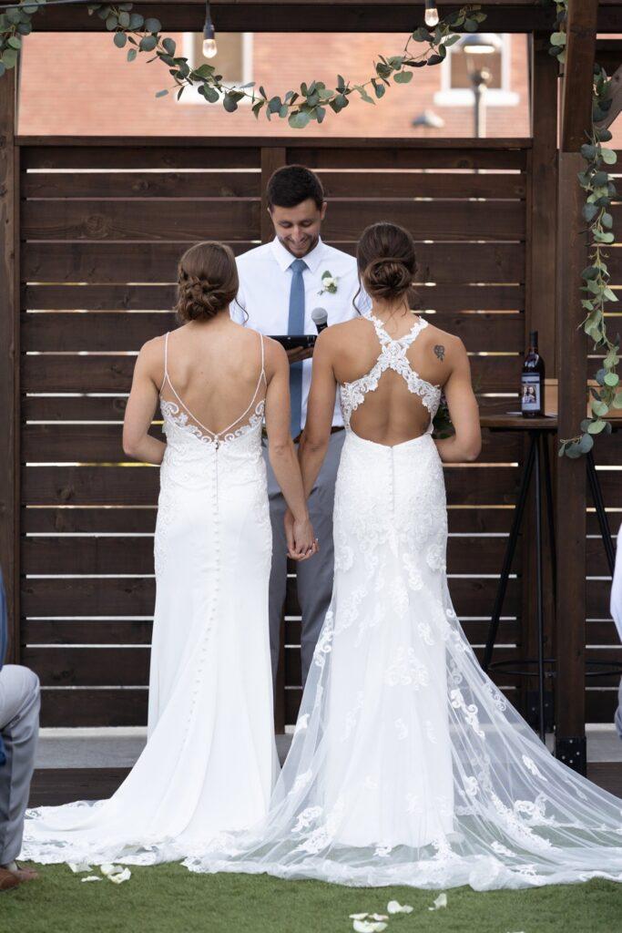 stella york brides at wedding ceremony - Style 6669 and Style 6767 by stella york